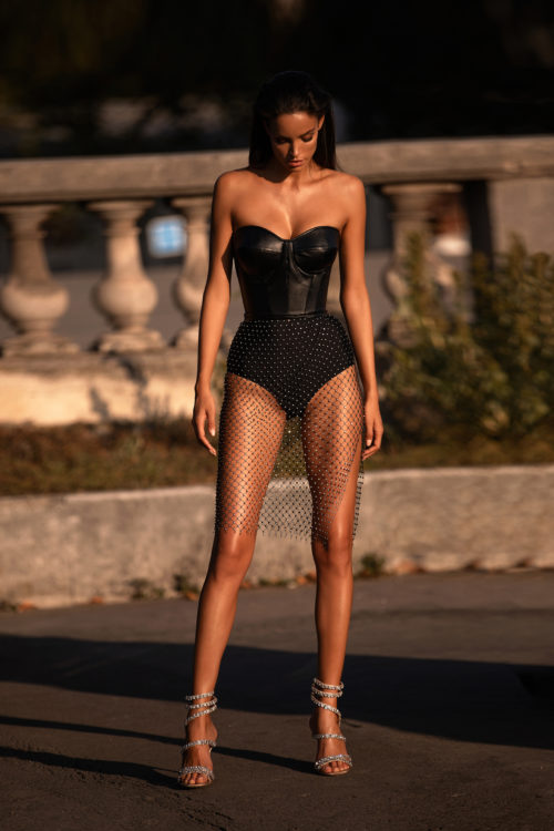 Short black dress with eco-leather corset
