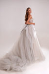 Strapless gown with floral ornament and extended train
