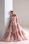 Blush gown with a frill-layered flared skirt
