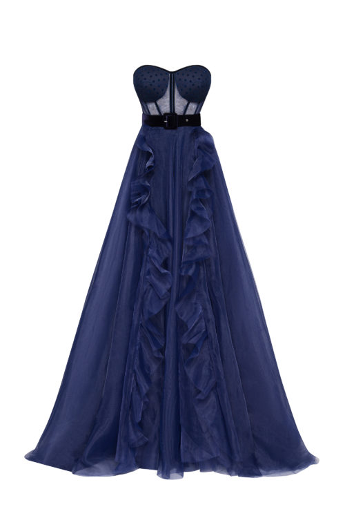 Royal blue gown with cascading skirt and puffy sleeves